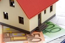 Haus und Geldscheine